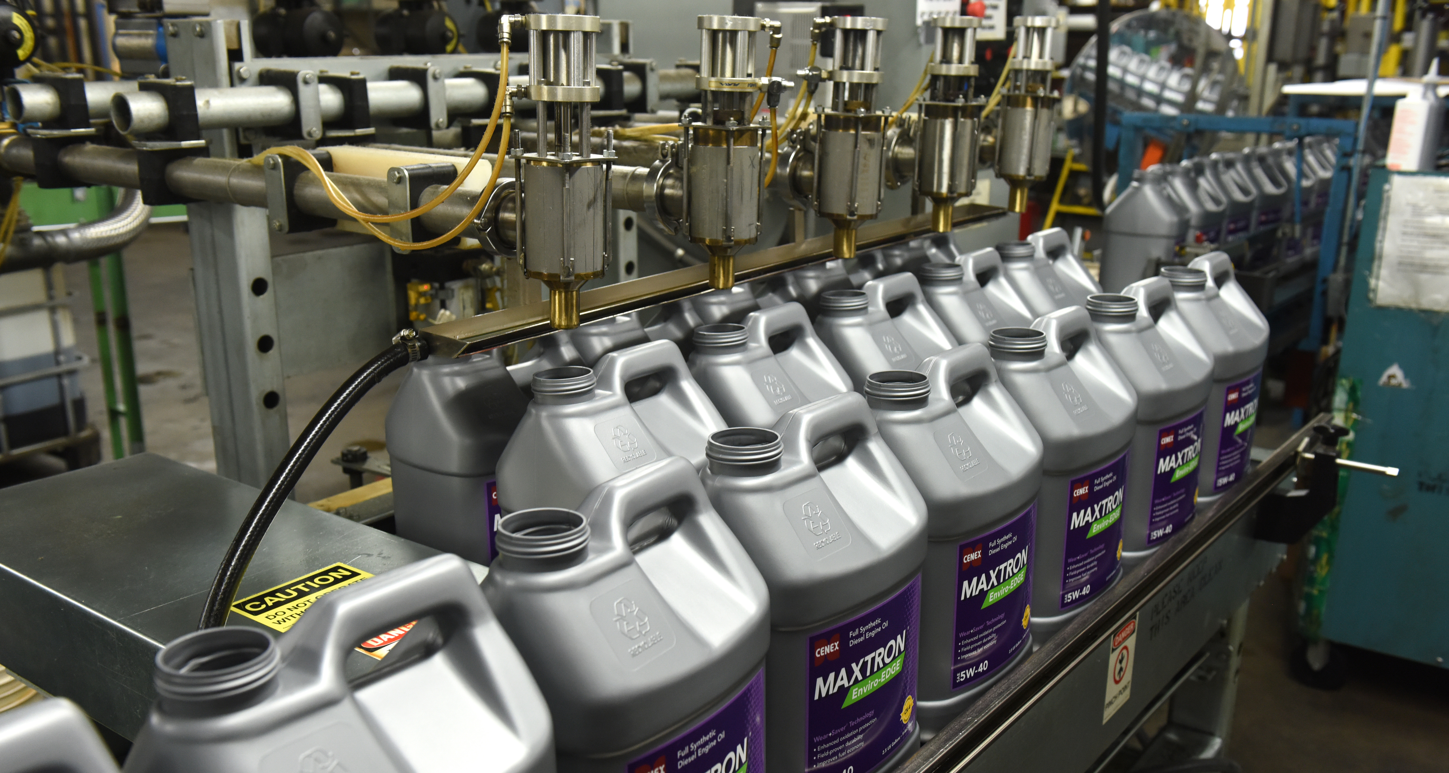 filling diesel engine oil jugs